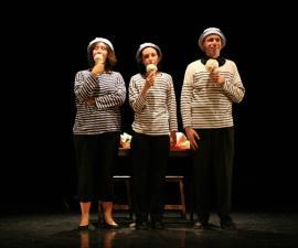 3 personnes sur scène